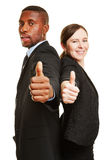Two businesspeople holding thumbs up Royalty Free Stock Photos