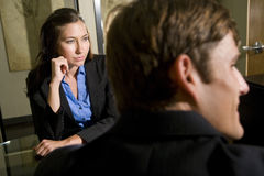 Two businesspeople listening in meeting Royalty Free Stock Photos