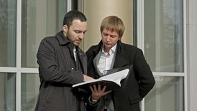 Two businesspeople looking at papers stock video footage
