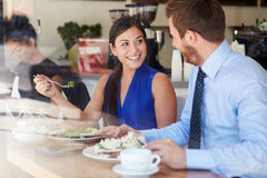 Two Businesspeople Meeting For Lunch In Coffee Shop Royalty Free Stock Photos