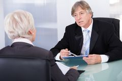Two Businesspeople In Meeting Stock Photo
