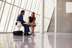 Two Businesspeople Meeting In Reception Of Modern Office Royalty Free Stock Images