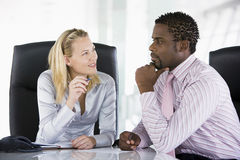 Two businesspeople in office talking.  royalty free stock photography