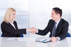 Two businesspeople shaking hand Stock Photos