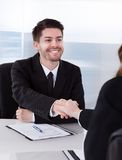 Two businesspeople shaking hand Stock Images