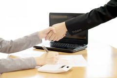 Two Businesspeople shaking hands indoors Royalty Free Stock Image