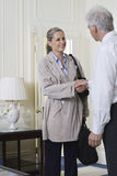Two Businesspeople Shaking Hands Indoors Stock Images
