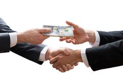 Two Businesspeople Shaking Hands And Receiving Banknote royalty free stock images