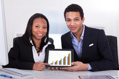 Two Businesspeople Showing Digital Tablet Royalty Free Stock Images