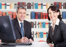 Two businesspeople sitting at office desk Royalty Free Stock Images