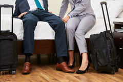 Two businesspeople with suitcase in hotel room Stock Photo