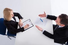 Two Businesspeople Talking With Each Other Stock Photography