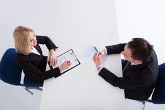 Two businesspeople talking with each other Stock Photos