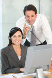Two businesspeople using computer Stock Images