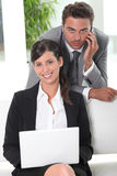 Two businesspeople in waiting area stock photo