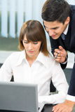 Two businesspeople working Royalty Free Stock Image