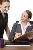 Two businesspeople working at desk in office Royalty Free Stock Photo