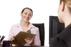 Two businesspeople working at desk in office Royalty Free Stock Photography