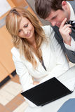 Two businesspeople working on a presentation Stock Photos