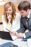Two businesspeople working on a presentation Stock Images