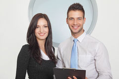 Two businessperson standing and smiling Royalty Free Stock Photos