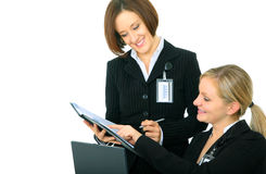 Two Businesswoman Arranging Agenda Royalty Free Stock Images