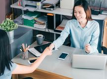 Two businesswoman handshake in causal meeting at home office desk about business planing,business teamwork,top view of asian. Business consulting together stock photography