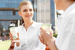 Two businesswoman having a coffeebreak. Two attractive businesswoman talking during coffeebreak outdoors Royalty Free Stock Image