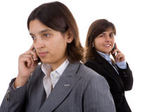 Two businesswoman holding mobile phones Royalty Free Stock Photos
