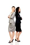 Two businesswoman leaning on each other. Royalty Free Stock Images
