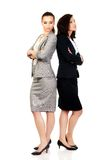 Two businesswoman leaning on each other. Stock Images