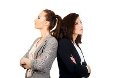 Two businesswoman leaning on each other. Royalty Free Stock Image
