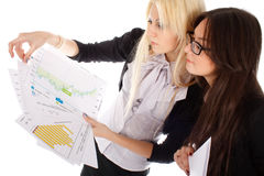 Two businesswoman looks on the graph royalty free stock photography
