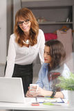 Two businesswoman meeting in office Stock Photos
