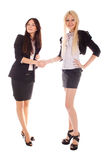 Two businesswoman shake hands Stock Photography