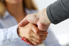 Two businesswoman shake hands as hello Royalty Free Stock Image