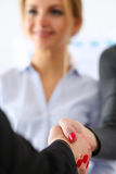 Two businesswoman shake hands as hello Stock Photos
