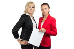 Two businesswoman and sheet of paper Royalty Free Stock Photo