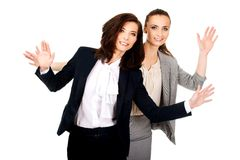 Two businesswoman showing her palms. Royalty Free Stock Images