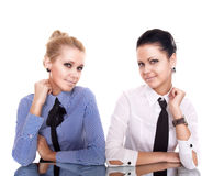 Two businesswoman siting on reflection table Royalty Free Stock Photo