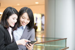 Two businesswoman use phone Stock Image