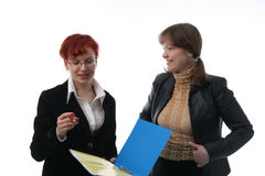 Two businesswomen. Communicate with each other Royalty Free Stock Photo
