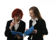 Two businesswomen. Communicate with each other Royalty Free Stock Image