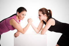 Two businesswomen arm wrestling Royalty Free Stock Images