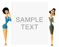 Two businesswomen with banner Royalty Free Stock Photos
