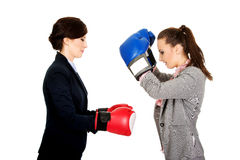 Two businesswomen with boxing gloves. Stock Photo