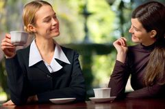 Two businesswomen chatting Stock Image