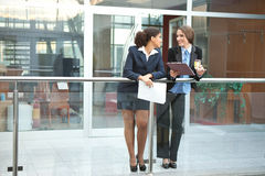 Two businesswomen chatting Stock Images