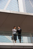 Two Businesswomen Chatting Outside Office Royalty Free Stock Images