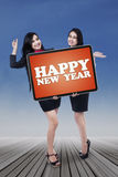 Two businesswomen congratulate happy new year Royalty Free Stock Photo